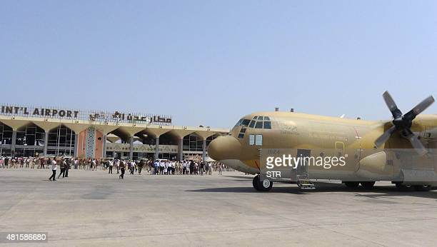 A Saudi military plane carrying relief aid is seen parked on the tarmac at Aden's international airport in Yemen's second city of Aden on July 22...