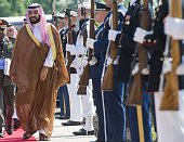 Saudi Minister of Defense Deputy Crown Prince Mohammed bin Salman walks past an honor guard as he arrives to attend a meeting of defense ministers of...