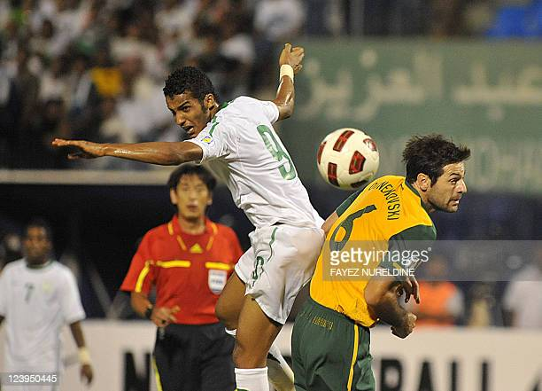 Saudi Nayef Ahmed and Australia's defender Sasa Ognenovski fight for the ball during during their 2014 World Cup Asian zone qualifying football match...