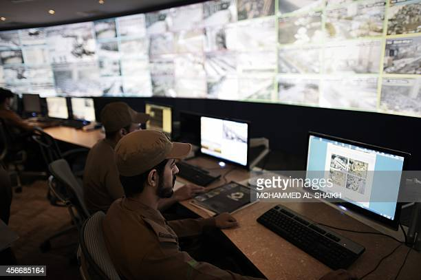Saudi officers are seen on duty at the command and control operation center in Mina near the holy city of Mecca on October 5 2014 Saudi Arabia said...