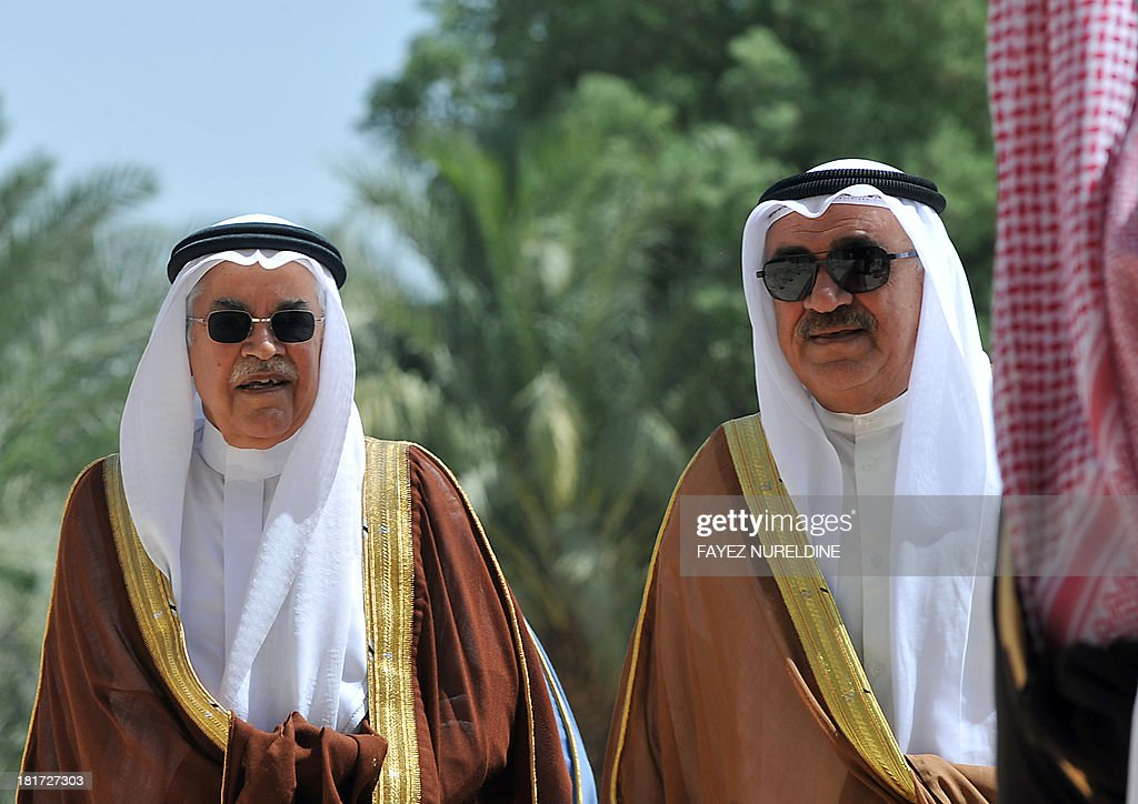 Saudi Oil and Energy Minister Ali Al-Naimi (L) escorts his Bahraini counterpart Ahmed bin Mohammed al-Khalifa during the 32nd ordinary meeting of the Oil Ministers of Gulf Cooperation Council (GCC) for the Gulf states held in Saudi capital of Riyadh, on September 24, 2013. AFP PHOTO/FAYEZ NURELDINE
