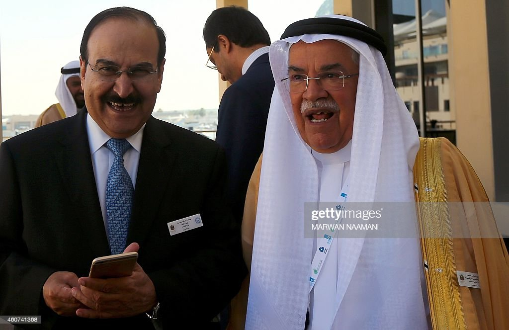 Saudi Oil Minister Ali al-Naimi (R) stands with Bahraini Oil Minister Abdulhussain bin Ali Mirza during the opening session of the 10th Arab Energy Conference in Abu Dhabi, on December 21, 2014. 'Irresponsible' levels of output by producers from outside the OPEC oil cartel is among the main causes of the slump in prices, the United Arab Emirates energy minister told the energy forum. AFP PHOTO/MARWAN NAAMANI
