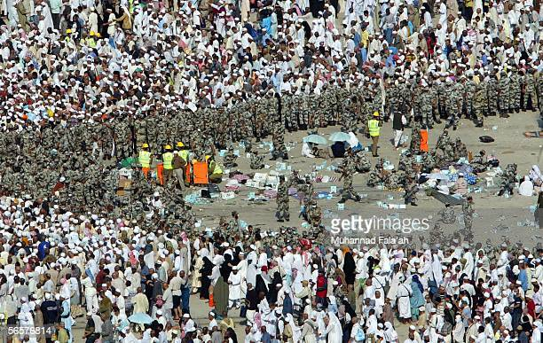Saudi paramedics evacuate the wounded and provide aid to others as Saudi security forces organize Muslim pilgrims stoning a pillar representing the...
