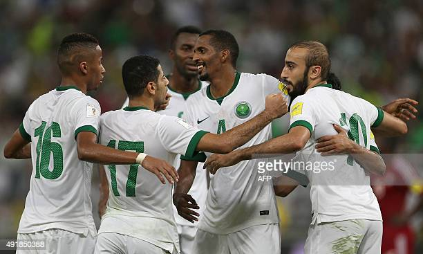 Saudi players celebrate their goal during the AFC qualifying football match for the 2018 FIFA World Cup between Saudi Arabia and United Arab Emirates...