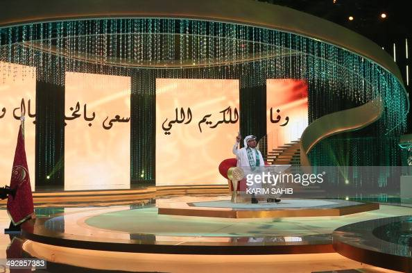 Saudi poet Mastur alOtaibi recites a poem praising Abu Dhabi's Crown Prince Sheikh Mohammed bin Zayed alNahyan during the shooting of the awards...