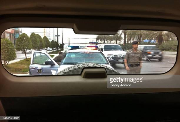 Saudi police approach the vehicle of a woman who drove in Riyadh Saudi Arabia while accompanied by her husband during a call for women to come out...