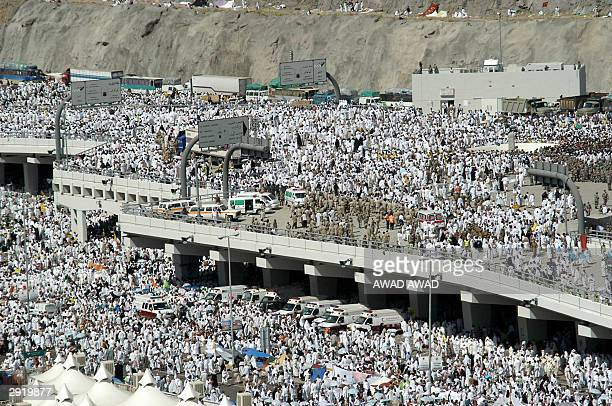 Saudi policemen and national guard members are deployed following the stampede in the Mina valley near the Saudi holy city of Mecca 01 February 2004...