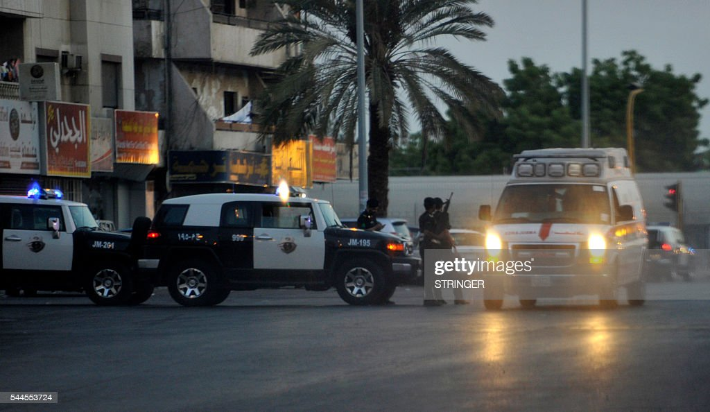 Saudi policemen stand guard at the site where a suicide bomber blew himself up in the early hours of July 4 2016 near the American consulate in the...