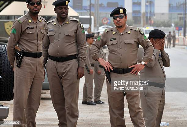 Saudi policemen stand guard in front of the 'Public grievances Department' building in Riyadh on March 11 2011 as Saudi Arabia launched a massive...