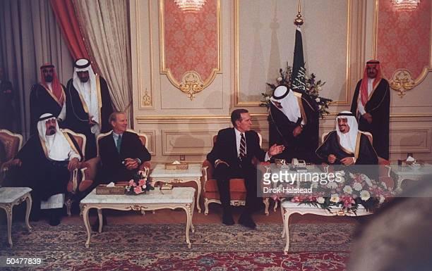 Saudi Prince Abdullah US State Secy Jim Baker Pres Bush King Fahd sitting discussing gulf crisis w translators assist ing hovering over