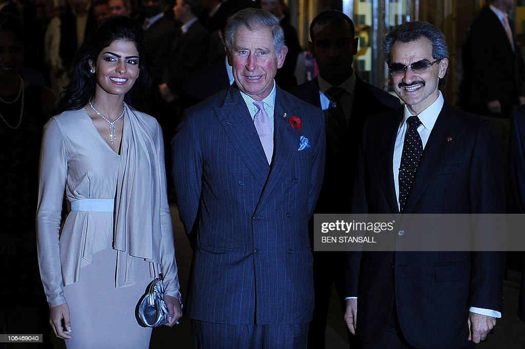 Saudi Prince Alwaleed Bin Talal (R), and his wife Amira (L), welcome Britain�s Price Charles (C), as he arrives to officially re-open the newly restored Savoy Hotel in London, on November 2, 2010. London's first luxury hotel, which hosted luminairies from Marlene Dietrich to Claude Monet, has been renovated from top to bottom in a mammoth project costing 220 million pounds (250 million euros, 350 million dollars).