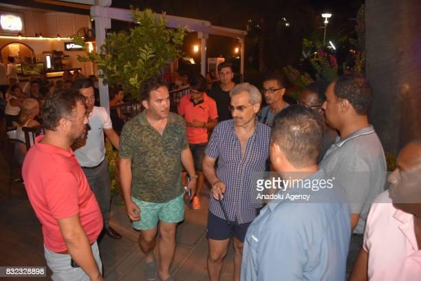 Saudi Prince AlWaleed Bin Talal bin Abdulaziz al Saud arrives at a restaurant at Marina district with Advisor to the Turkish Prime Ministry Taha Genc...