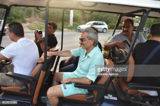 Saudi Prince AlWaleed Bin Talal bin Abdulaziz al Saud takes a buggy ride while returning to the hotel at Bodrum in Mugla Province of Turkey on August...