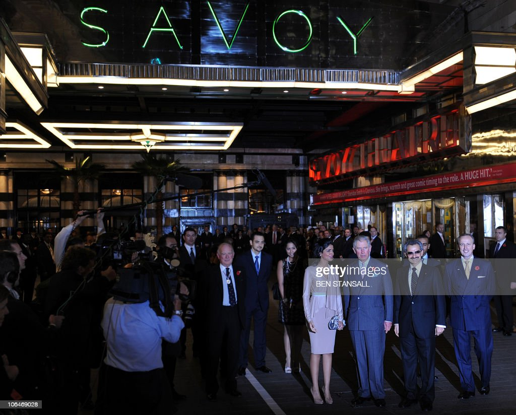 Saudi Prince Alwaleed Bin Talal (2nd R), his wife Amira (4th R), welcome Britain�s Prince Charles (3rd R), as he arrives to officially re-open the newly restored Savoy Hotel in London, on November 2, 2010. London's first luxury hotel, which hosted luminairies from Marlene Dietrich to Claude Monet, has been renovated from top to bottom in a mammoth project costing 220 million pounds (250 million euros, 350 million dollars).