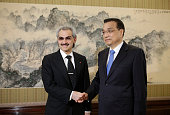 Saudi Prince Alwaleed bin Talal shakes hands with China's Premier Li Keqiang during their meeting at Zhongnanhai in Beijing on May 18 2016 / AFP /...
