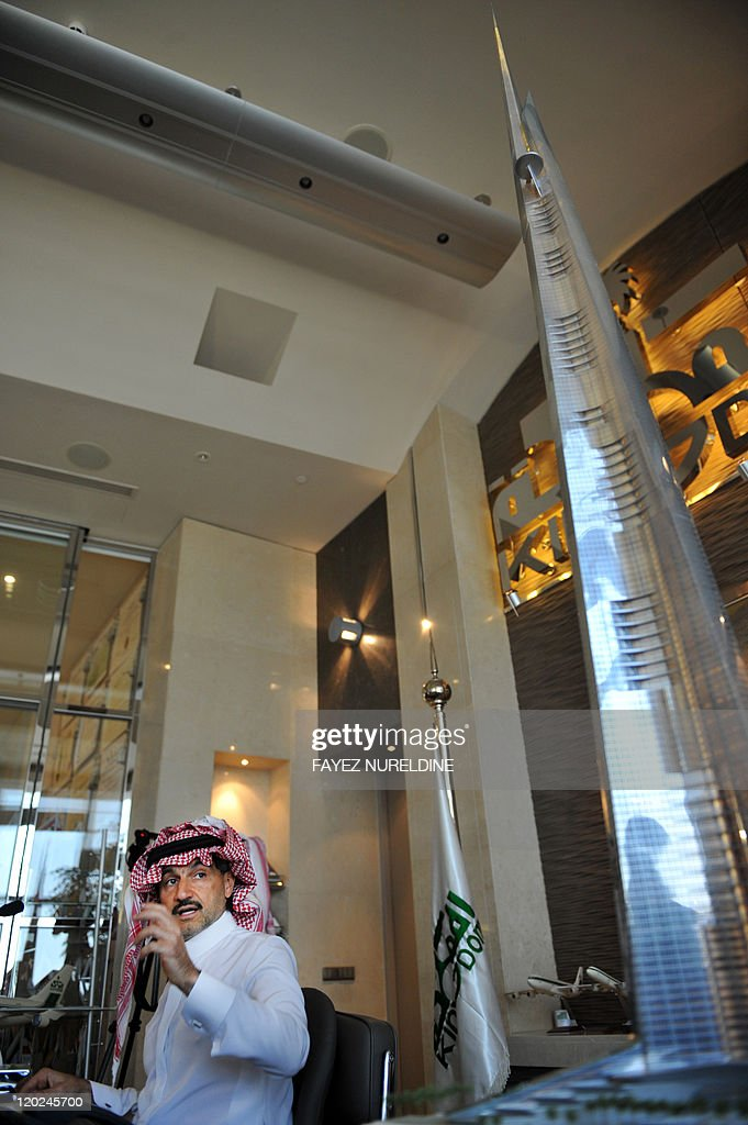 Saudi Prince Alwaleed bin Talal speaks next to a model of the world's tallest tower to be built in the Red Sea city of Jeddah during a press...