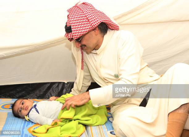 Saudi Prince Alwaleed bin Talal visits the tent of Syrian refugees who came from Idlib during his visit to Zaatari camp for Syrian refugees on April...