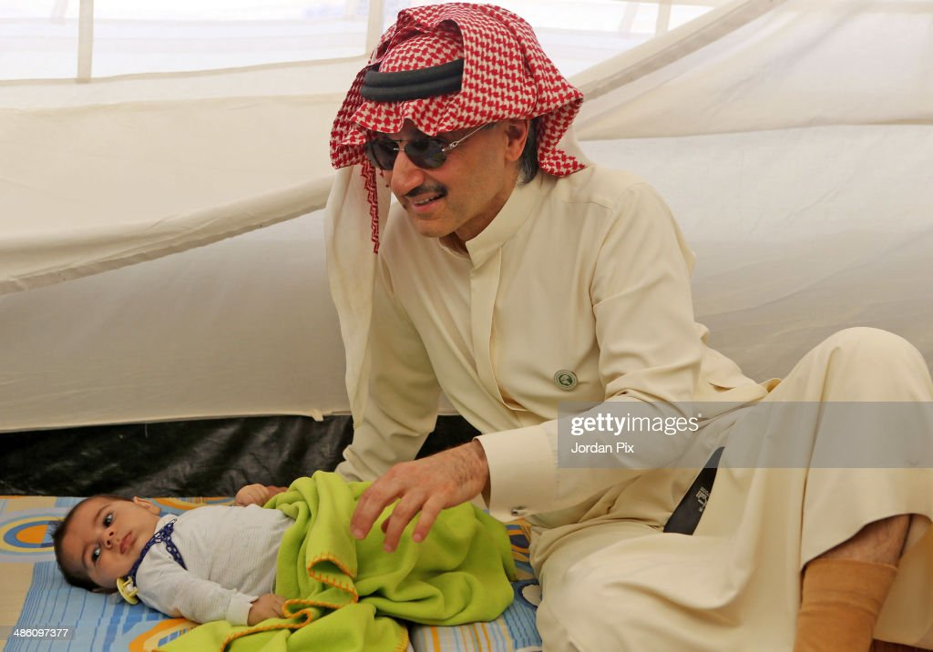 Saudi Prince Alwaleed bin Talal visits the tent of Syrian refugees who came from Idlib during his visit to Zaatari camp for Syrian refugees on April 22, 2014 in Zaatari, Jordan. Prince Alwaleed bin Talal, one of the world's most high-profile investors, visited the camp to assess the needs of those seeking refuge from the ongoing conflict in Syria.