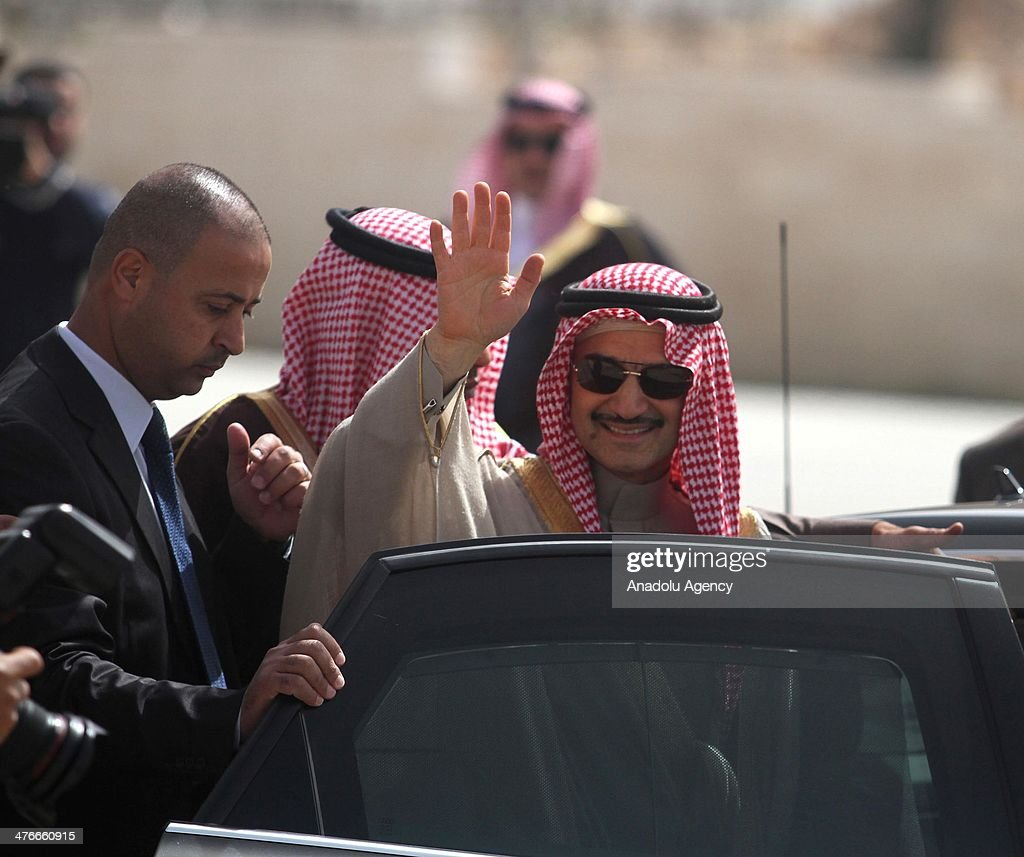 Saudi prince Al-Waleed bin Talal waves during an official visit to the West Bank city of Ramallah on March 4, 2014.