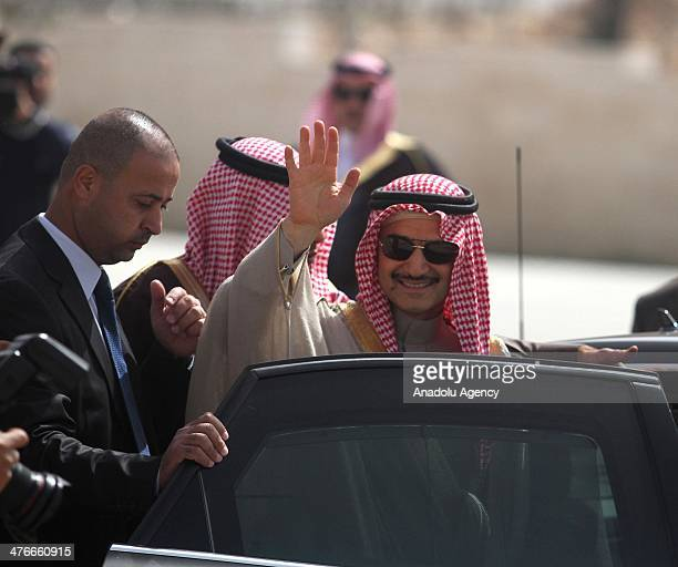Saudi prince AlWaleed bin Talal waves during an official visit to the West Bank city of Ramallah on March 4 2014