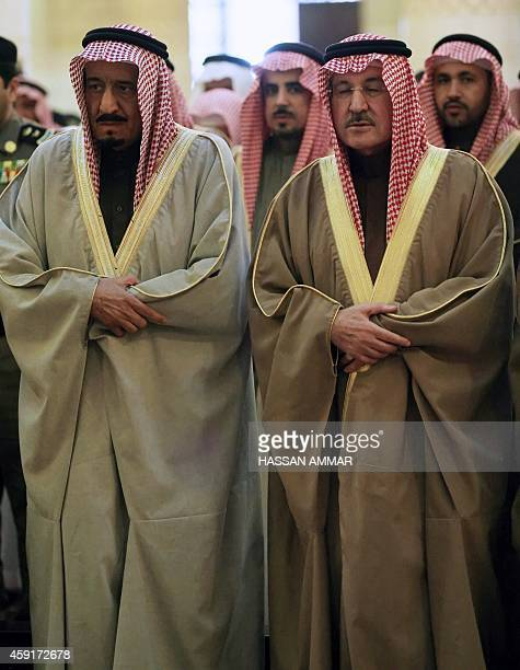 Saudi Prince Salman Bin Abdel Aziz AlSaud and his brother Prince Sattam pray at the funeral on February 6 in Riyadh of Saudi security attache to Chad...