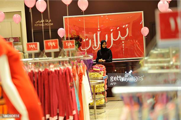 A Saudi saleswoman waits for customers at a lingerie shop for women and families only in the Saudi Red Sea port of Jeddah on January 2 2012 From this...
