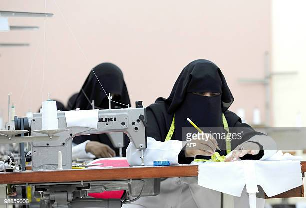 Saudi seamstresses work at a factory in the Red Sea city of Jeddah on August 21 2009 The factory is run by Saudi designer Siraj Sanad who specialises...