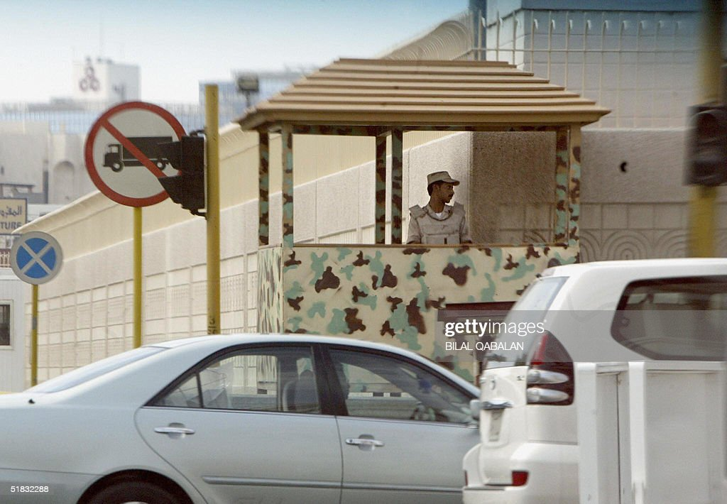 Saudi security guard monitors movement outside the walls of the US consulate in the Red Sea port city of Jeddah 07 December 2004 Osama bin Laden's...