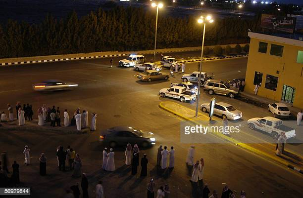 Saudi security men and rescuers are deployed around the oil processing plant of the state oil giant Aramco in Abqaiq in the oilrich Eastern Province...