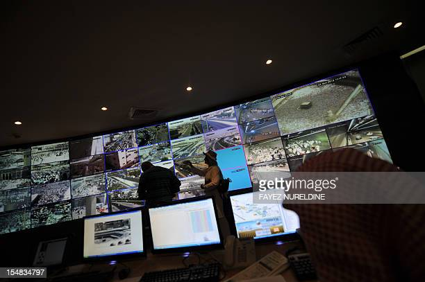 Saudi security personnel monitor the screens as they follow the hajj pilgrimage from the control room on the second day of Eid alAdha in Mina near...