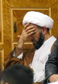 Saudi Shiite Muslim cleric Hasan Safar prays during a memorial ceremony held at a mosque in the eastern city of Dammam on the eve of the final day of...