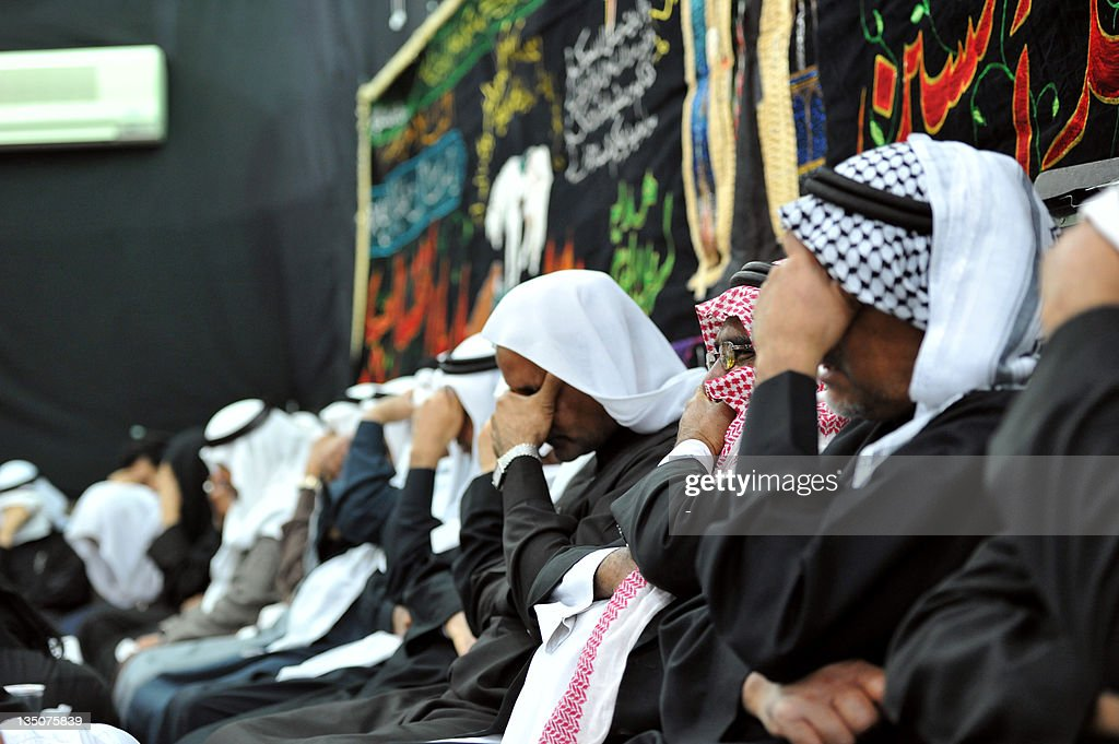 Saudi Shiite Muslim men mourn during Ashura commemorations which mark the killing of Imam Hussein grandson of Prophet Mohammed in the mostly Shiite...