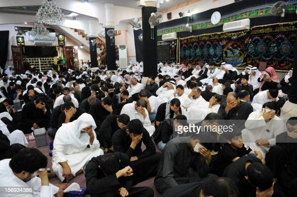 Saudi Shiite Muslim men mourn during the commemoration of Ashura which marks the 7th century killing of Imam Hussein grandson of Islam's Prophet...
