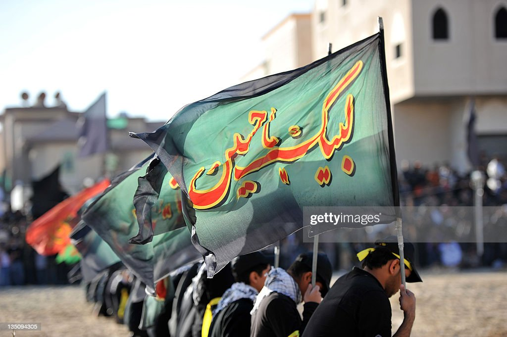Saudi Shiite Muslim men take part in Ashura mourning rituals to commemorate the killing of Imam Hussein grandson of Prophet Mohammed in the mostly...