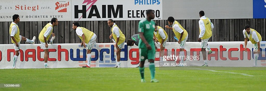 Saudi substitute players stretch during their friendly match between Saudi Arabia and Nigeria in Alpen stadium in Tyrolian Wattens on 25 May 2010 prior to the FIFA World Cup 2010 hosted by South Africa.