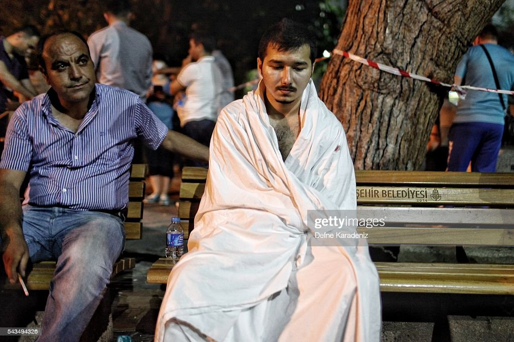 A Saudi tourist who survived the Ataturk Airport suicide bomb attack waits for his wounded mother outside the Bakirkoy Sadi Konuk Hospital, in the early hours of June 29, 2016 in Istanbul, Turkey. Three suicide bombers opened fire before blowing themselves up at the entrance to the main international airport in Istanbul, killing at least 31 people and wounding 147 people according to Justice Minister Bekir Bozdag.