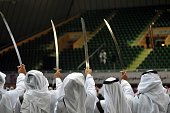 Saudi traditional dance team perform with swords during the traditional Saudi dancing best known as 'Arda' during the Janadriya culture festival at...