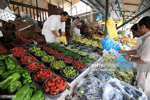 Saudi vendors sell vegetables at Otaiga public market in the Manfouha district of the capital Riyadh on June 17 2015 as the faithful prepare for the...