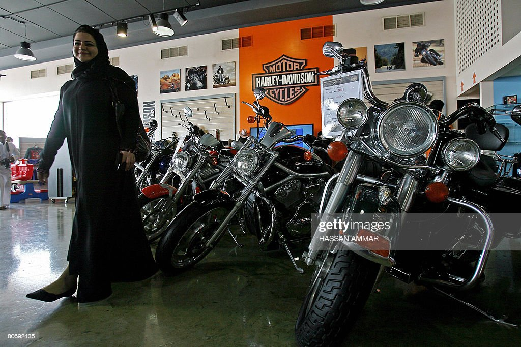 a saudi woman admires brand new harley davidson motorcycles in a show pictures getty images. Black Bedroom Furniture Sets. Home Design Ideas