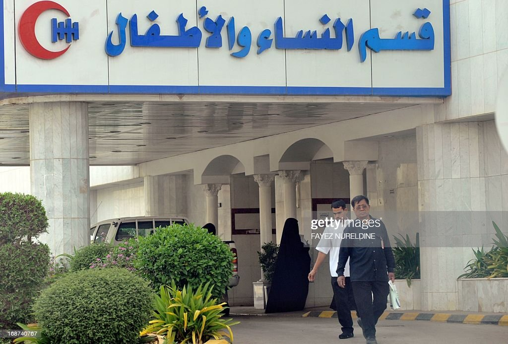 A Saudi woman and foreigners are seen at the entrance of a hospital in the center of the capital Riyadh, on May 14, 2013. Four more cases of the deadly coronavirus have been detected in Saudi Arabia, the health ministry said, raising the number of people infected from the SARS-like virus in the kingdom to 28, including 15 fatalities.