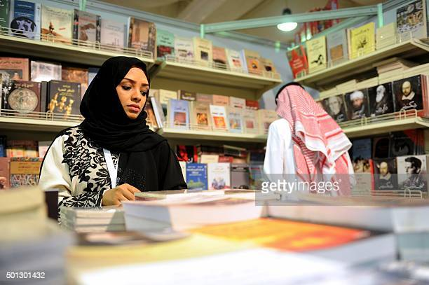 A Saudi woman attends the Jeddah International Book Fair on December 13 2015 in the Red Sea city of Jeddah AFP PHOTO / STR / AFP /