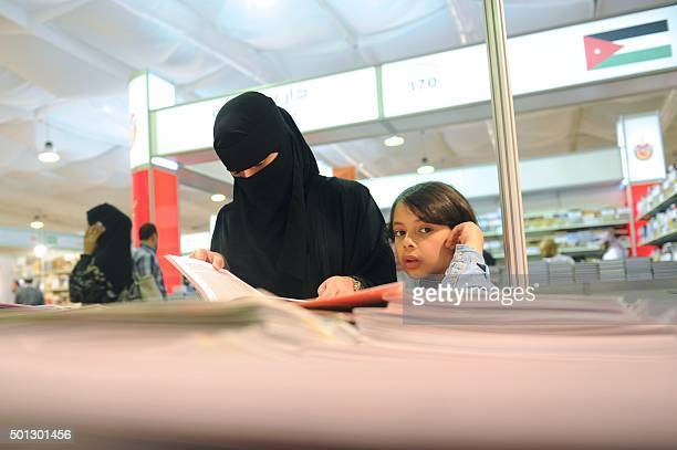 A Saudi woman attends the Jeddah International Book Fair on December 13 2015 in the Red Sea city of Jeddah AFP PHOTO / STR / AFP /