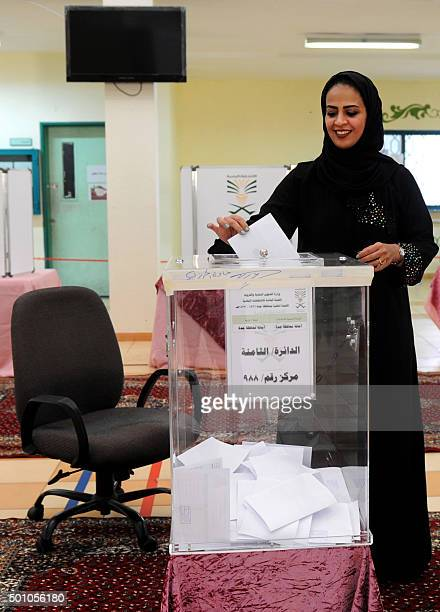 A Saudi woman casts her ballot in a polling station in the coastal city of Jeddah on December 12 2015 Saudi women were allowed to vote in elections...