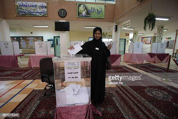Saudi woman casts her vote for the municipal elections at a polling station on December 12 2015 in Jeddah Saudi Arabia Saudi Women are running the...