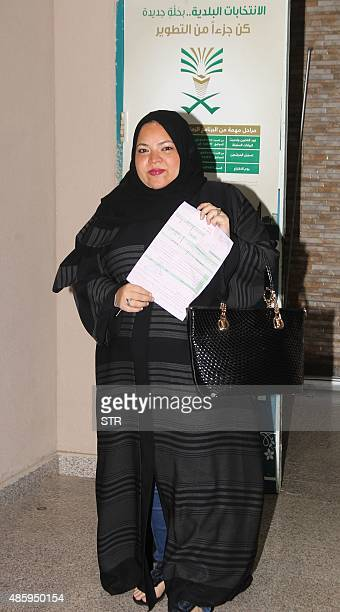 A Saudi woman holds an application as she heads to register to vote in the port city of Jeddah on August 30 2015 Saudi Arabia allowed women to...