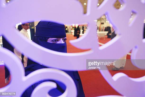 Saudi woman looks on during the first annual Bab Rizq Jameel a threeday job opportunity fair for Saudi youth where candidates are interviewed by...