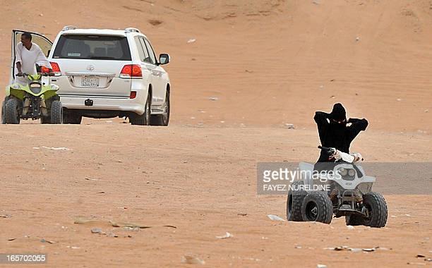 A Saudi woman prepares to drive an ATV at Thumamah Park near Riyadh on April 5 2013 Saudi Arabia's religious police have lifted a ban on women riding...