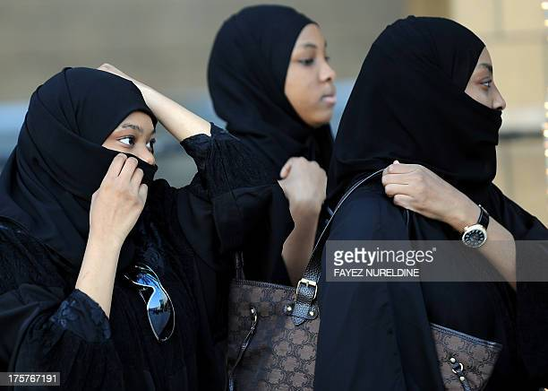 Saudi women arrive to attend the morning Eid alFitr prayer at Turki bin Abdullah grand mosque in Riyadh on August 8 2013 Muslims worldwide observe...