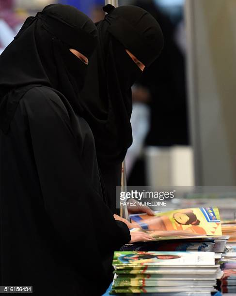 Saudi women browse books during the annual Riyadh International Book Exhibition in the capital Riyadh on March 17 2016 Over 500 publishing houses and...