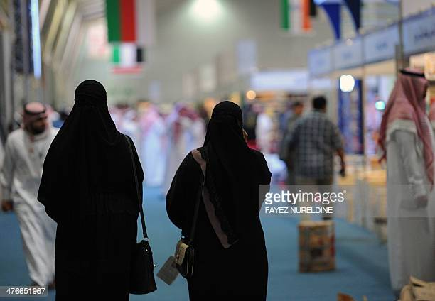 Saudi women browse the annual International Book Exhibition in the capital Riyadh on March 4 2014 There are 1700 publishing houses participating in...